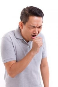 A man coughing